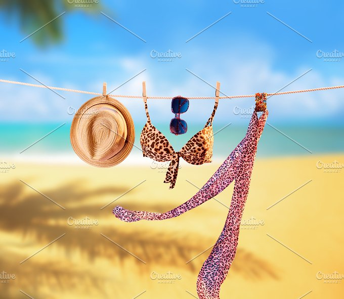Beach outfit. Summer clothes set on tropical sea - Holidays