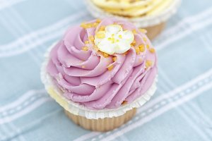 Two pastel cupcakes: pink & yellow