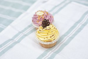 Two cupcakes in pastel colours