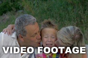 Grandparents kissing dear grandson