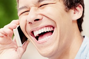 Laughing guy with smartphone