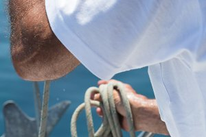 Close-up of sailor holding rope