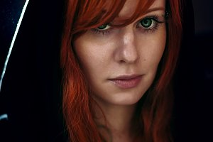 Dramatic portrait of red hair woman