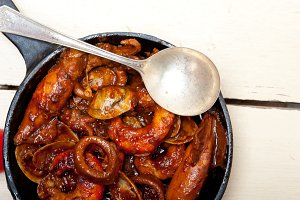 seafood stew on iron skillet