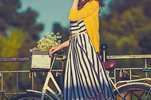 Girl on a bike ride with a retro hipster bike