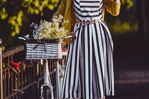Young beautiful, elegantly dressed woman with bicycle. Beauty fashion and lifestyle