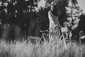Young beautiful, elegantly dressed woman with bicycle. Beauty,fashion and lifestyle
