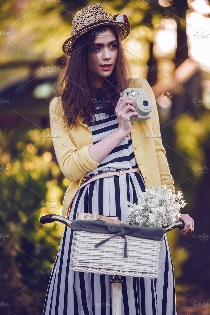 Young beautiful, elegantly dressed woman with bicycle. Beauty, fashion and lifestyle - People
