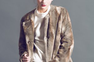 fashion woman in  brown fur coat pose