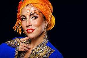 Oriental beauty in turban. Face art