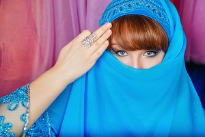 Oriental beauty hides her face