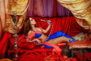 Oriental beauty is smoking hookah