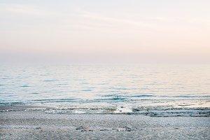Peaceful scene of a calm sea at sunset