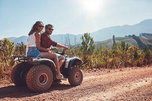 Couple enjoying a quad bike ride