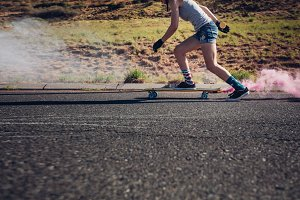 Young woman longboarding