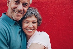 Cheerful mature couple embracing