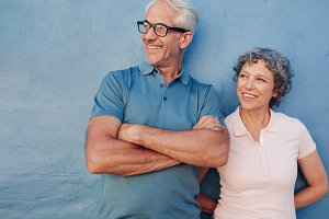 Smiling mature couple standing