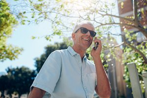 Mature man talking on mobile phone