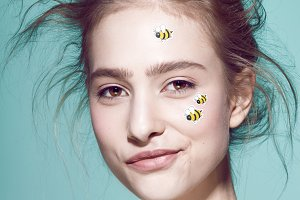 Funny make-up professional style for yong fashion model. Sticker on face