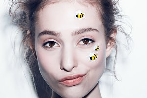 Funny make-up professional style for yong fashion model. Sticker on face.