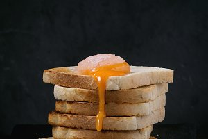 Toasts with yolk over black