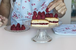Woman preparing cake with berries