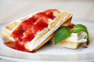 Belgian waffles with strawberry sauce