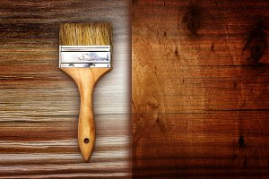Renovation brush on wooden texture