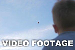 Boy Waving to Sky Lantern