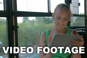 Smiling woman communicating on pad