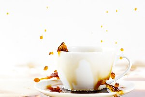Cup of spilling coffee