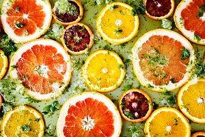 Oranges and grapefruits cut