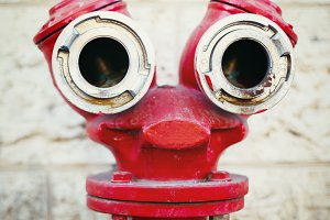 Red old fire hydrant on a street
