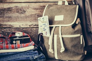 Travel backpack, clothing and camera