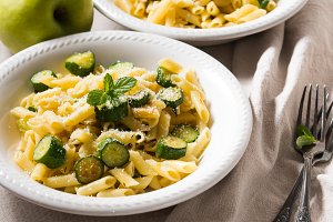 Pennette pasta with zucchini, mint leaves and parmesan