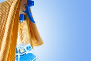 Glass cleaner spray bottle on blue