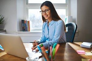 Female entrepreneur working on laptop