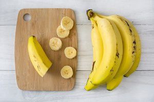 Bananas on white table