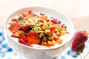 Smoothie bowl with strawberries, dried fruit and chia seeds
