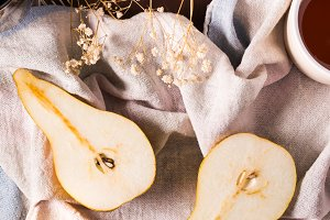 Pears on rustic background