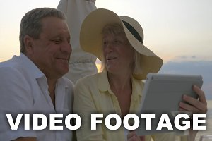 Mature Couple Watching Photos
