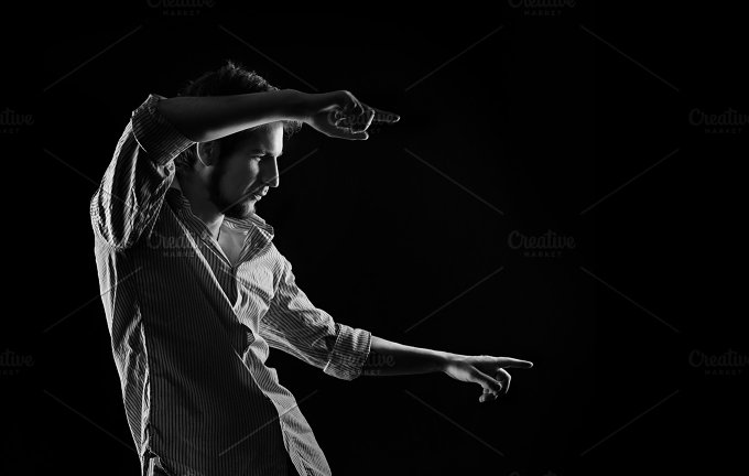 Man showing forefingers. B&W - Business
