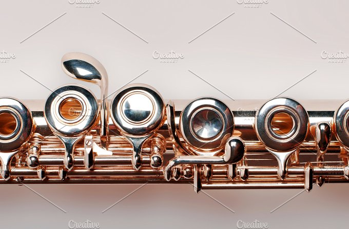 Golden flute. isolated on brown background - Arts & Entertainment