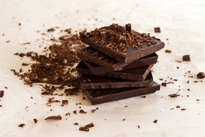 Pieces of chocolate bar. Food photo.