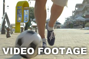 Man dribbling a football outdoor