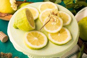 Sliced lemon on green