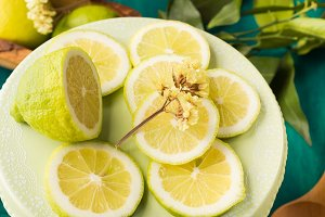 Sliced lemon on green