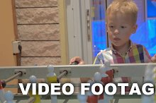 Boy Learning to Play Foosball