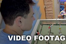 Father and Son Playing Foosball