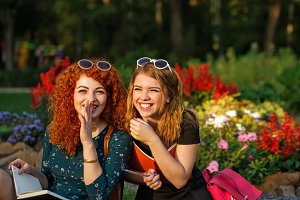 Girlfriends students laugh in park